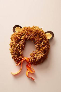 This woolly lion mane, complete with adorable felt ears, is the perfect costume for an animal party or for roaring around the house and garden. It easily ties on with an orange ribbon. Yarn mane with felt ears Orange ribbon tie Pack size: x x Baby Lion Costume, King Costume, Baby Costumes, Halloween Costumes For Kids, Halloween Diy, Halloween Decorations, Dog Lion Mane, Lion Party, Kids Dress Up