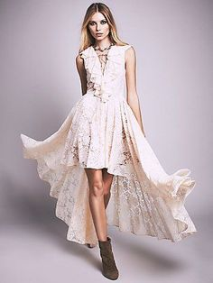 Goddess Lace Dress | Beautifully intricate floral lace dress featuring a plunging neckline with lace-up detail. Ruffled overlay along the bust and shoulders for a cap-sleeve effect. High-low hem lends way to a dramatic, sweeping silhouette. Hidden side zip for an effortless fit. Fully lined.
