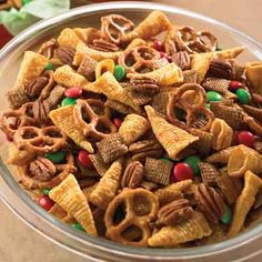 This snack mix recipe is both sweet and salty! The praline-like coating covers the salty nuts and crisp cereal for an irresistible combination.