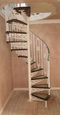 Cast Metal Spiral Staircase With Wooden Steps and Balcony Rails