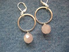 Handmade dainty pink quartz bead earrings! These dangle from  sterling silver circles.