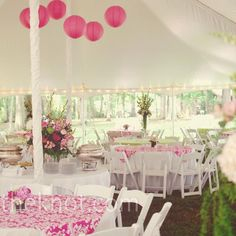 Pink damask fabric and large pink paper lanterns can give a white reception tent a burst of color and texture | Photo by: Alea Moore Photography