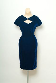 Vintage late 50s early 60s blue velvet dress with  * cutout neckline & rhinestone * Blue velvet * sleeves * Fully lined in blue rayon * Center