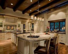 Kitchen design. Log beams, two islands