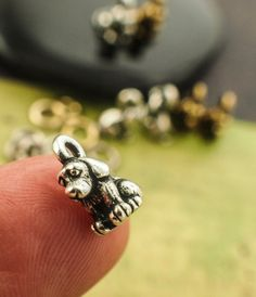2 Patient Dog Charms - Silver Plate, Gold Plate with Matching Jump Rings - Made in the USA - 10mm X 7mm X 5mm - Authentic Tierra Cast $2.20