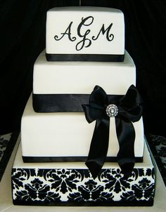 square black and white - damascus print and monogram wedding cake