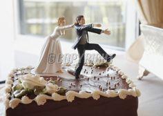 Funny wedding cake top bride chasing groom
