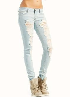 I want a pair of full on ripped light colored jeans like this.