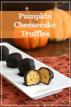 Creamy low carb pumpkin cheesecake bites enrobed in dark chocolate. Fun and delicious!