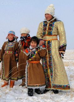 A woman and her children in traditional holiday attire of the Mongolian ethnic group watch camels racing at an ice and snow carnival in West Ujimqin Banner, north China's Inner Mongolia Autonomous Region, Jan. Mongolia, Costume Ethnique, Foto Poster, Tribal People, Ethnic Dress, Folk Costume, Central Asia, Ethnic Fashion, World Cultures