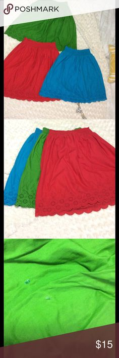 Old Navy Cotton Red/Green/Blue Skirts These cute skirts are light and airy, perfect for those hot summer months! No size listed on tag but seems like Red is xsmall and green/blueXXS. They have elastic bands so have plenty of stretch. Hit right above knee if worn above hips. Red skirt in perfect UC. Green has a few spots, one is possible bleach (tiny dot on blue skirt also) and two hardened small spots like glue. Otherwise EUC. Selling as a set of 3 Old Navy Skirts A-Line or Full