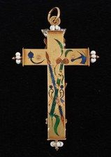 The back of the Spanish gold crucifix, early 17th century. Back of the cross enameled with the Instruments of Passion (not all identified, but: spear, hammer, scourge).
