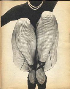 black fish nets & black ballet slippers.