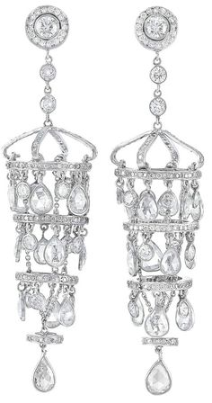 Pair of Platinum and Diamond Fringe Pendant-Earclips 32 round & 26 pear-shaped rose-cut diamonds ap. 9.75 cts., small round diamonds, one small diamond missing, ap. 19.8 dwt.