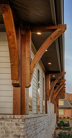 Exterior details Cedar corbels and built in exterior lighting compliment this light brick house with hardie board.