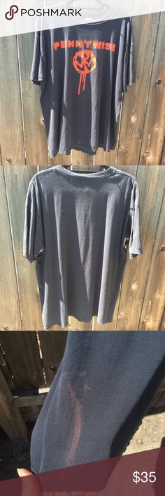 """VTG 90s PENNYWISE BLACK T-SHIRT SZ 2XL VTG 90s PENNYWISE BLACK T-SHIRT SZ 2XL- front red graphic on front -armpit to armpit 25"""" front length 28""""- discoloration at side see pix! This shirt is very hard to find!! Get it now! Vintage Shirts Tees - Short Sleeve"""