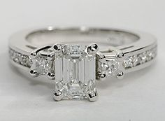Elegant in design, this petite diamond engagement ring showcases ten round pavé-set diamonds with two princess-cut side diamonds and your diamond of choice set in 14k white gold. Setting includes 1/3 carat total diamond weight.