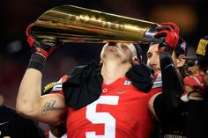 Linebacker Raekwon McMillan #5 of the Ohio State Buckeyes celebrates with the trophy after defeating the Oregon Ducks 42 to 20 in the College Football Playoff National Championship Game at on Jan. 12, 2015 in Arlington, Texas.