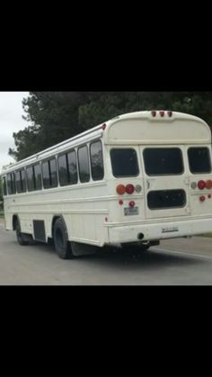 White School buses with windows painted black near Raleigh, North Carolina