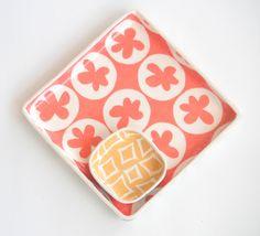 Ceramic serving tray, grapefruit pink spinning flower motif. $85.00, via Etsy.
