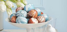 Try this for Easter: Position a flower or a leaf on your egg, then wrap it with panty hose and secure with a twist tie. Dye your eggs like normal. When they're dry and cool, remove the panty hose, and voila! Beautiful botanical eggs. Check out more egg dying ideas: http://www.countryliving.com/crafts/easter-egg-decorating-ideas