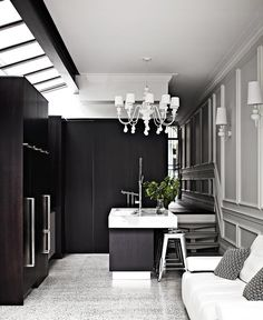 This sophisticated kitchen is kept sleek with several appliances hidden behind the kitchen cabinetry. Take a tour of this [contemporary terrace home] *Photo: Sharyn Cairns* Small Rooms, Small Spaces, Real Living Magazine, Weatherboard House, Recycled Brick, Kitchen Design Open, Victorian Terrace, Art Deco Home, Stylish Kitchen