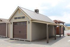 1220 New England Shed with painted board & batten siding heritage garage Garage Roof, Garage Exterior, Shed Roof, Car Garage, Diy Shed Plans, Garage Plans, Garage Ideas, Garage Kits, Detached Garage Designs