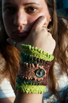 Cuff pattern by Talitha Kuomi on etsy - very long triangle with buttonhole at the end corner