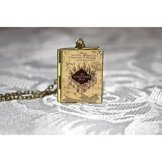 Harry Potter Marauder's Map Book Locket (£17) ❤ liked on Polyvore featuring jewelry, pendants, vintage locket, vintage jewellery, locket jewelry, chains jewelry and vintage jewelry