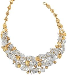 Gold, Platinum and Diamond Bib Necklace, David Webb.     18 kt., centering an openwork bib of diamond-set platinum leaves, accented by rope-twist stylized acorns tipped with diamonds and gold leaves, totaling approximately 648 round diamonds approximately 27.00 cts., completed by textured gold stylized branch links, signed Webb, 2 extra links, 8 diamonds missing, approximately 157 dwt. Length 17 inches. Via Doyle New York.