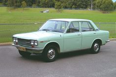 Datsun 1600 Auto De Luxe Sedan - this was my first car, in khaki. Will buy it back if I drive past it.
