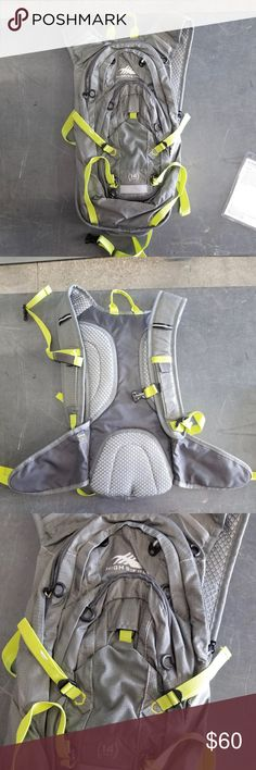"""NWOT High Sierra Gray 14L Gamma Hydration Pack NWOT High Sierra Gray 14L Gamma Hydration Pack. Brand new, never used. Features multiple compartments, stretch mesh back panel, 2L hydration system (comes with 2L reservoir), organizer with keyfob, stretch front pocket, tuck away helmet holder, adjustable side and bottom compression straps, waist belt with zippered pockets, and reflective loop. Check out my other bags & hydration packs for sale, I have a ton!   Size: 18"""" x 8.8"""" x 4""""  *All…"""