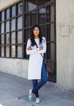 Sheryl Luke is wearing a white long sleeved MissGuided tunic paired with denim Zara jeans