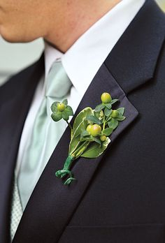 Hypericum berry boutonniere. Millie B Photography.