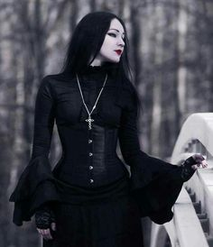 Who is this stunning gothic fashion model? Such a classic look - black corset, long straight black hair, and gothic cross pendant.