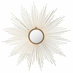 "Wall mirror with an iron sunburst frame.  Product: Wall mirrorConstruction Material: Iron and mirrored glassColor: GoldDimensions: 41"" Diameter"