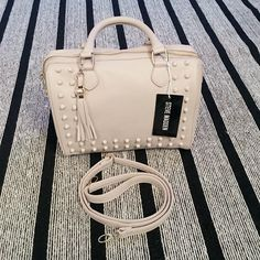 "Steve Madden Nude Studded Handbag NWT Steve Madden nude, monochromatic studded handbag with detachable cross body strap. Approximate measurements are 10"" x 12"" x 7""... Inside is lined with fabric and has pockets. Top zipper closure with gold plated hardware. Steve Madden Bags Satchels"