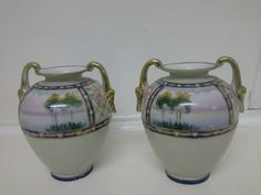 A near pair of decorative Japanese vases available from Mallingbournes