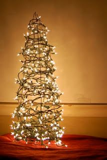 Tomato Cage Christmas Tree-- Did this last year!!  Great front porch decor!!