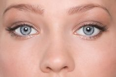 how to properly fake a wide-awake look using one of the oldest tricks in the beauty book: highlighting the inner corners of our eyes.