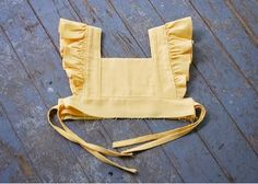 "Pretty, frilly, pinafores! Originally pinafores were a protective apron designed to keep the dress beneath clean. (The word 'pinafore' comes from the fact they were originally just ""pinned"" to the front, or ""fore"" of a dress.) Tie Dye Diva Storybook Pinafore Pattern What if you love their vintage, ruffly goodness but … well … just … Continue reading ""Tutorial Tuesday: Make a Wear-Alone Dress from the Storybook Pinafore Pattern"""