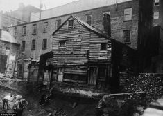 Jacob Riis - Living on the edge: View of a back-lot house on Bleecker Street between Mercer and Greene Streets, almost toppling into an excavation site