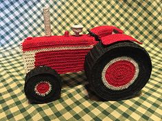 This is a pattern for a crocheted tractor that is stiffened over various easy to find items and then hot and fabric glued together. It is worked in basic crochet stitches and an advanced beginner could easily make this project. This project was made in size 10 crochet threads.