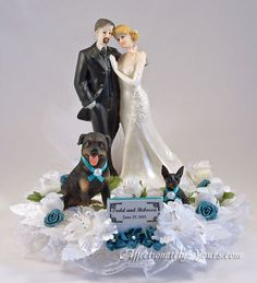 Customized dogs with bride and groom wedding cake topper. Shown with rottweiler and min pin in white with teal accents. Personalized hair color changes and goatee on groom. Includes name and wedding date plate.   http://www.affectionately-yours.com/yours-mine-and-ours-wedding-cake-topper/