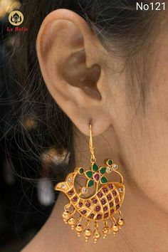 Cute Ear rings with meena design. Earring studded with pink green and white color stones. 11 February 2018