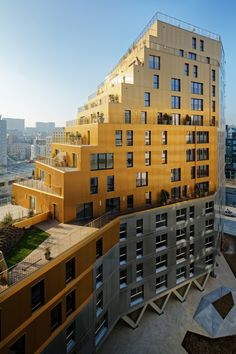 Paris' tallest housing block in over 40 years is clad with gold and silver metal Residential tower in Paris by Hamonic + Masson & Associés and Comte Vollenweider Architectes Architecture Résidentielle, Futuristic Architecture, Amazing Architecture, Contemporary Architecture, Building Facade, Building Design, Building A House, Habitat Collectif, Tower In Paris