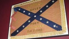 """As Fort McAllister fell to the Union Army of Gen. William T. Sherman days before Christmas in 1864, one of his artillery officers seized the Confederate flag of a vanquished company of Georgia riflemen. The officer carried the silk banner home to Maine as a souvenir, and it stayed in his family for three generations in a box along with a handwritten note: """"To be return to Savannah or Atlanta sometime."""""""