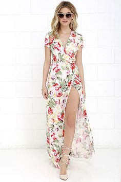 If you fancy the finer things, then let us introduce you to the Vine Art Ivory Floral Print Wrap Maxi Dress! Light and breezy woven rayon in a red, green, yellow and purple floral print covers short sleeves, a wrapping surplice bodice, and tying sash at the waist. Wrapped detail carries into a front slit maxi skirt.