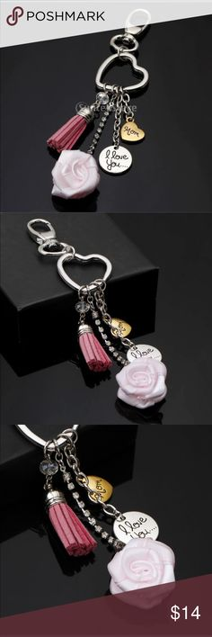 "I love you... mom key chain / purse clip New retail.  Silvertone. Goldtone heart reads ""mom"". Silvertone circle reads ""I love you..."" , pink leather tassel. Bling chain drops with a pink rose at the end. Can use as a key chain or hang in rear mirror or clasp to purse as decor. Super pretty. 6"" long Accessories Key & Card Holders"