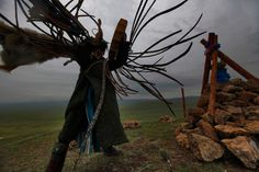 "eurasian-shamanism: "" Mongolian Shaman Gankhuyag Batmunkh dances in a trance during a Shaman ceremony by an 'ovoo' or 'sacred stone' site on Black Mountain Head in Nalaikh district of Ulan Bator in Mongolia, 06 July 2012. Photo and description by How..."